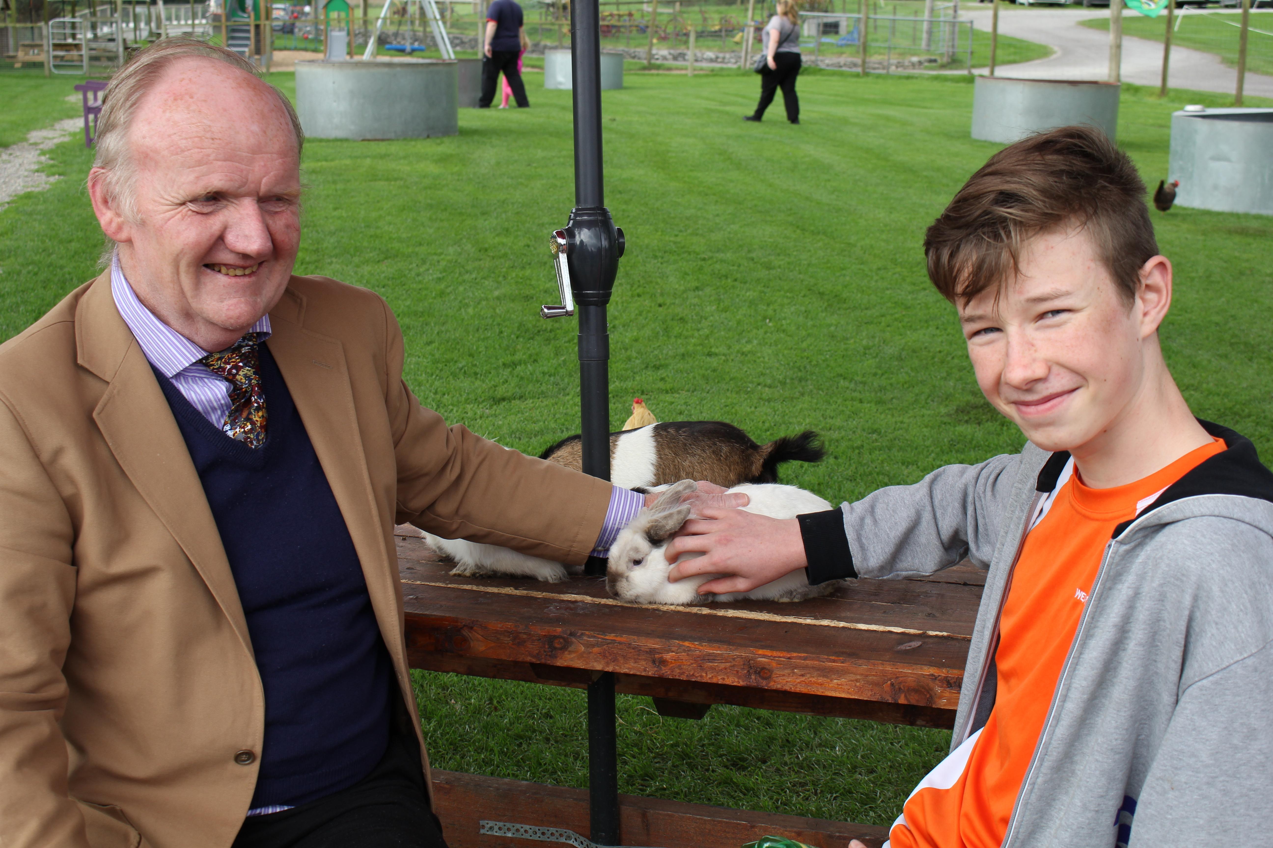 Colm Clifford and Cian Sheehan admiring rabbits